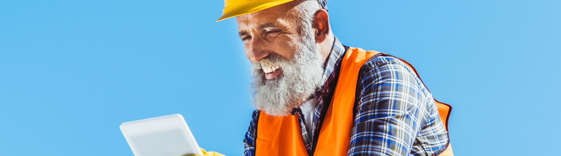 Construction worker smiling with tablet